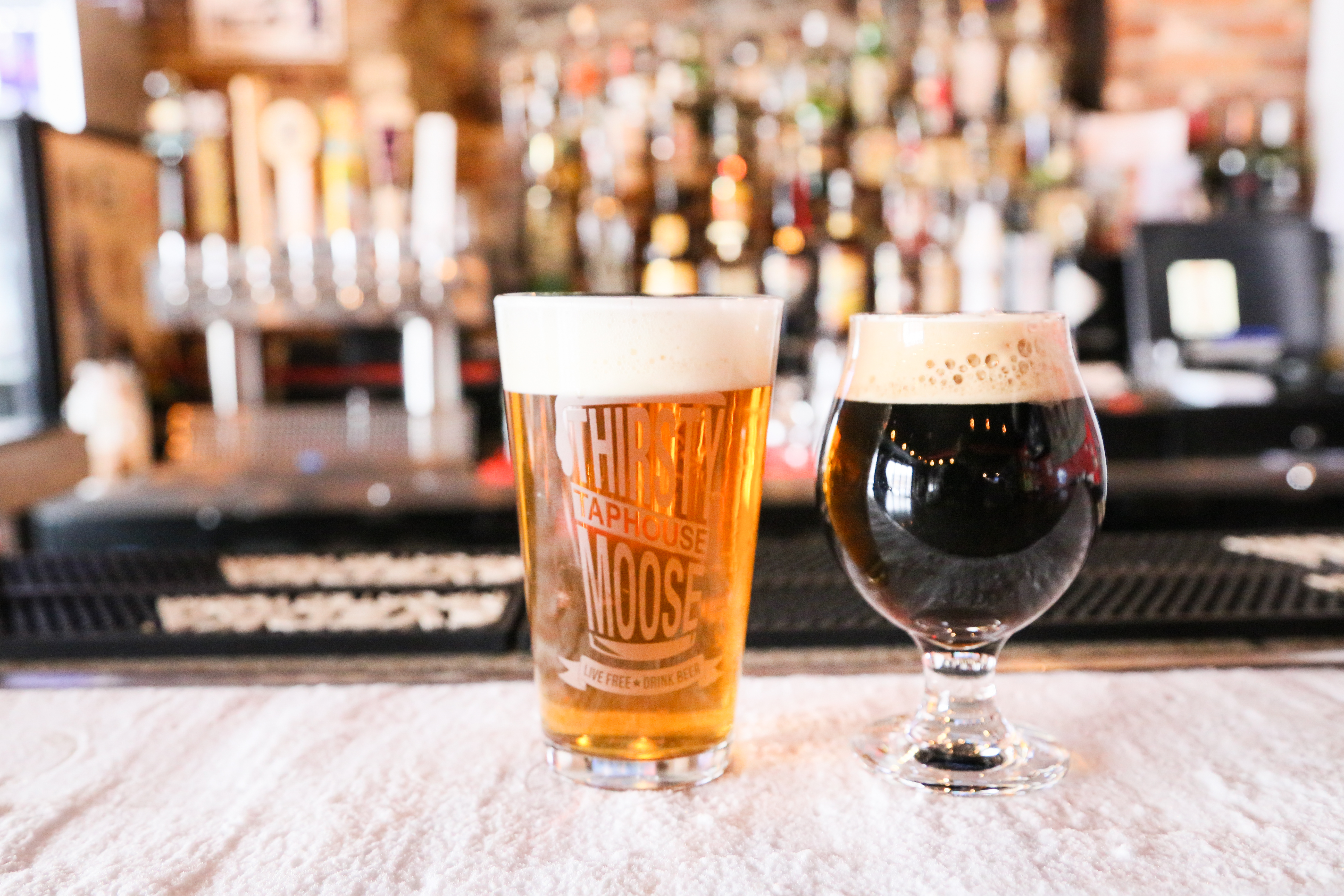 Two beer classes on bar top